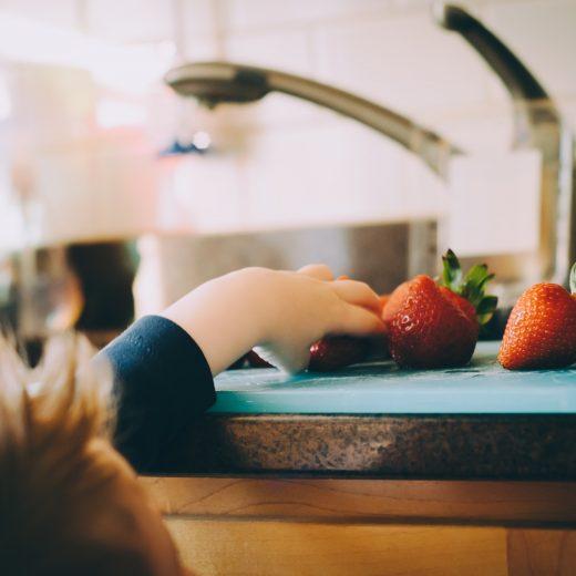Child grabbing strawberries